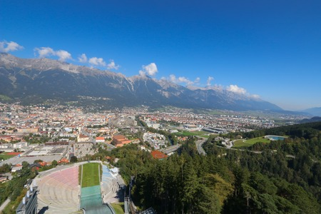 ski jump: View of Innsbruck city and partial part of the Bergisel Ski Jump tower, known as Bergisel Schanze, located on Bergisel hill in Innsbruck, Austria on September 23, 2014. It is one of the main attractions of the city of Innsbruck.