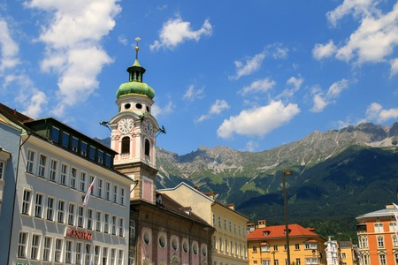 roman catholic: The Clock tower of the Spitalskirche Hospital Church on Maria Theresien street in Innsbruck, Austria on July 11, 2015. Spitalskirche was named after the hospital. It is the Roman Catholic Church that was built in 1701.