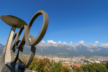olympic ring: The Olympic Winter Games rings and torches located on Bergisel hill in Innsbruck, Austria on September 23, 2014. Two cauldrons were lit to symbolize the Winter Games being held twice in Innsbruck in 1964 and 1976
