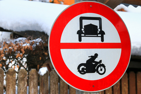 no entry: A road sign for no entry for cars and motorbikes at Hallstatt, Austria during Winter season