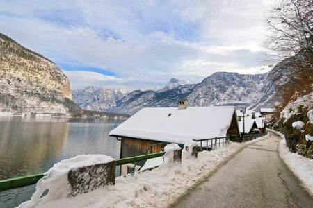 unesco world cultural heritage: A narrow paved street along lakeside at Hallstaetter See, Hallstatt Lake in Upper Austria in the winter Stock Photo