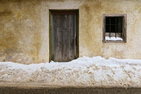 blocking: Street covered with snow blocking the entrance door during winter
