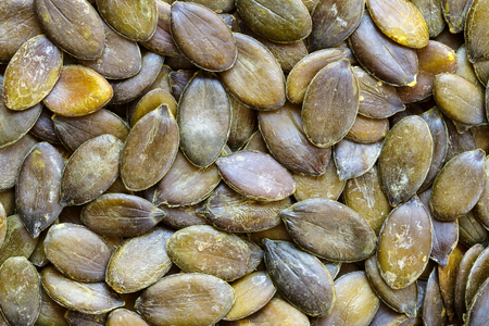 removed: Background of roasted Pumpkin seeds with white outer hull removed Stock Photo