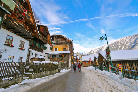 unesco world cultural heritage: People walking on street covered with snow along Hallstaetter See, Hallstatt Lake in Upper Austria in the winter on January 2, 2015 Editorial