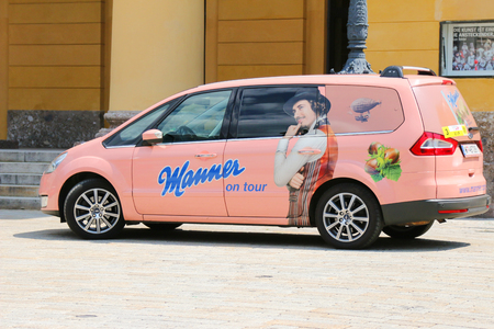 manufacturer: A pink car with sticker Manner on tour parking in Innsbruck, Austria on July 11, 2015. Manner is wafers manufacturer in Austria. Its celebrating its 125 years and conducing tours around many cities.