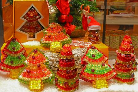 gummie: Display window of Gummy bears shaped to be different kinds of Christmas trees in Innsbruck, Austria on December 21, 2014. Gummy is a gelatin-based candy sold in different shapes, flavors, colors. Editorial
