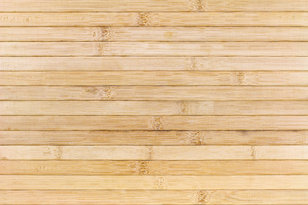 Closeup background photo of texture of wooden mat made of bamboo wood, Asian style Standard-Bild