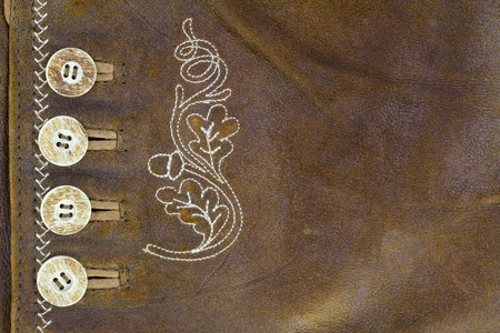 brown skin: Closeup texture background of natural brown leather made of goat skin with buttons and handmade stitch