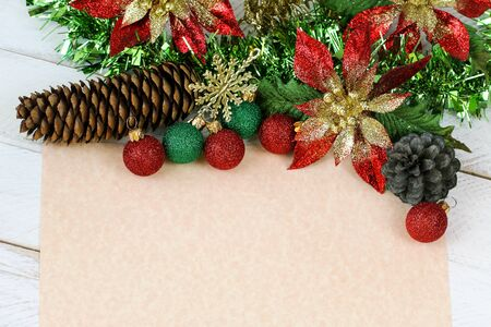 glittery: Blank beige paper to write wish lists with glittery Christmas decoration Stock Photo