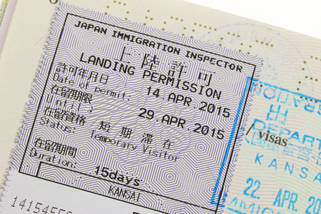 Duration: Closeup of the Landing Permission sticker with stamp on a passport for immigration traveling in Japan for 15 day duration