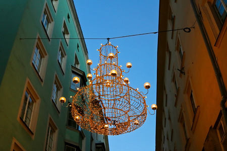 christkindlmarkt: Night view of one of the Christmas Lights, a huge Chandelier hanging to decorate street in Innsbruck, Austria