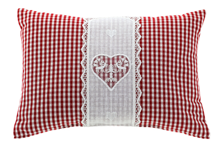 pines: Closeup of a red gingham pillow with flake of Swiss stone pine inside, decorated with hand-made vintage crochet lace, isolated on white background Stock Photo