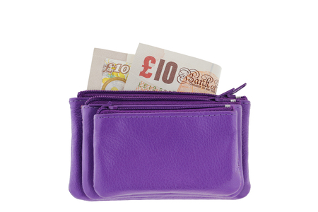mini purse: Purple multi layered leather zippered coin pouch with Pound banknote inside, isolated on white background Stock Photo