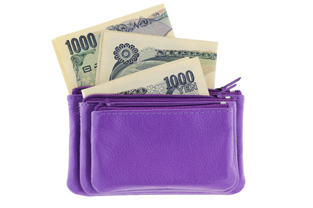 Purple multi layered leather zippered coin pouch with Japanese Yen banknote inside, isolated on white background