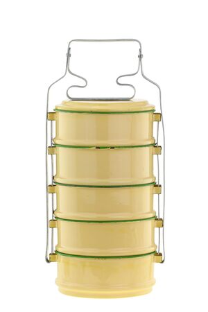 tiffin: Vintage metal food carrier, known as Tiffin carrier, in yellow and green color isolated on white background