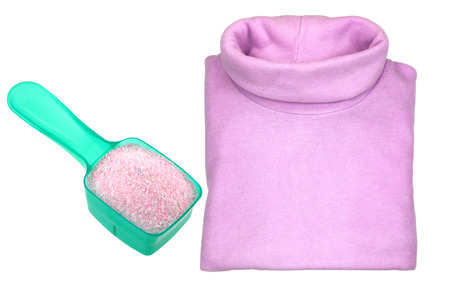 necked woman: A pink heat retaining extra warm folded turtleneck t shirt with a spoon of washing Powder,  isolated on white background Stock Photo