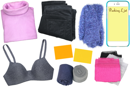 woman clothes: A set of clothes, sticky notes and a smartphone with packing list on its screen isolated on white