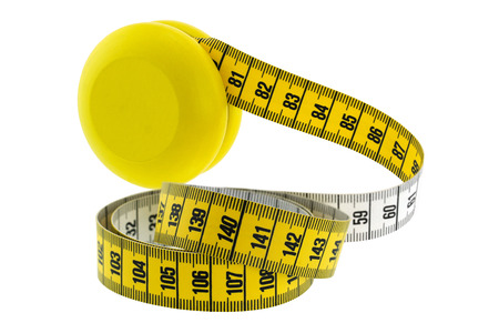 regain: A wooden yellow YoYo with yellow measuring tape, isolated on white represent the idea of Yo-Yo dieting Effect Stock Photo