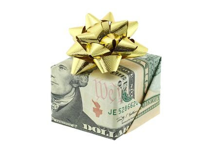 alexander hamilton: A gift box wrapped with United stated bills decorated with golden gift ribbon,  isolated on white background
