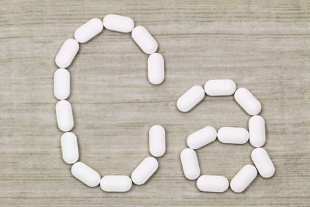 Top view of white Calcium carbonate tablets in a symbol shape of Ca alphabet Stock Photo