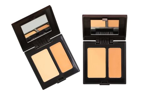 undereye: Closeup photo of a concealer palettes in different shades to conceal under-eye circles or facial blemishes, isolated on white