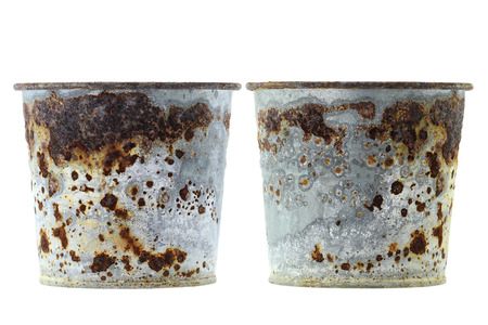 flaky: Rusty plant pots full of reddish brown flaky coating of iron oxide