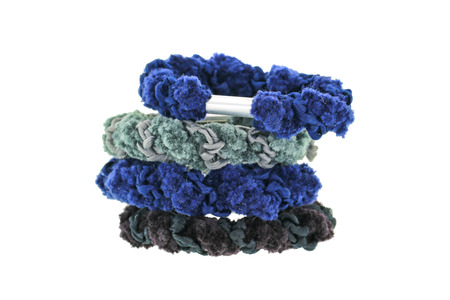 hair band: A stack of elastic head dressing, hair ties in blue and black shade isolated on white Stock Photo