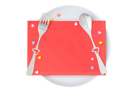 envelop: Red envelop with heart shaped fork and spoon on top of white plate, isolated on white Stock Photo
