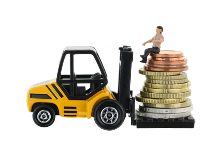 miniature: Soft focus of a miniature man sitting on a pile of Euro coins on a forklift truck, isolated on white Stock Photo