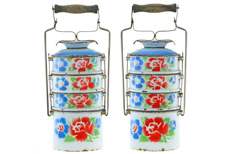 tiffin: Vintage rusty metal food carrier (Tiffin carrier) in white with colorful flowers isolated on white background