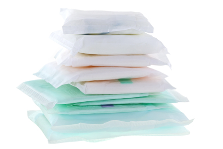 sanitary towel: A pile of different types and sizes of Sanitary napkins (sanitary towel, sanitary pad, menstrual pad) isolated on white