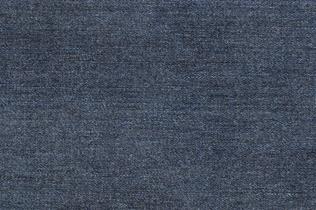 jean: Closeup background photo of texture of midnight blue denim jeans textile