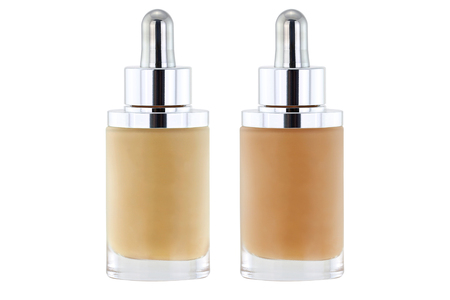light complexion: Glass Bottles of liquid foundation with dropper in pink and yellow undertone isolated on white Stock Photo