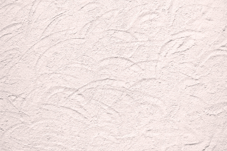 dabs: Closeup background texture photo of rough plaster wall with circular dabs in pink shade Stock Photo