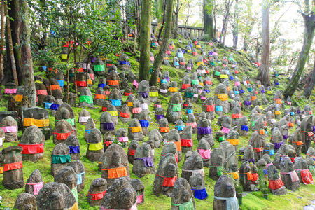 believed: Thousand stone statues of Jizo Bosatsu Ksitigarbha at Jojuin Temple, Kyoto, Japan. It is believed to protect bad spirits to children Editorial