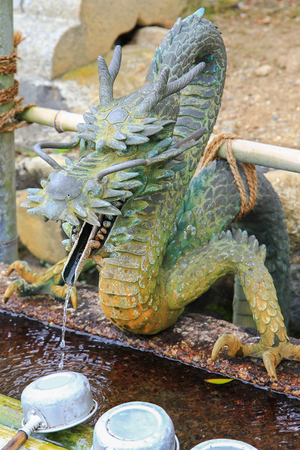 purify: Water running out through Dragon s mouth to water basin at Nigatsu-do Hall, Nara, Japan. It is to purify oneself before visiting shrine in Japan
