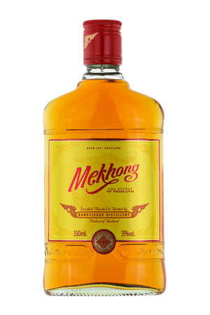 distilled: BANGKOK, THAILAND - DECEMBER 2015 : A 350ml. bottle of Mekhong whisky isolated on white in Bangkok, Thailand on December 21, 2015. Mekhong is a Thai rum distilled from 95 sugar cane and 5 rice Editorial