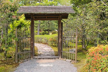 wood door: Simple looking wooden gate with roof inside the garden