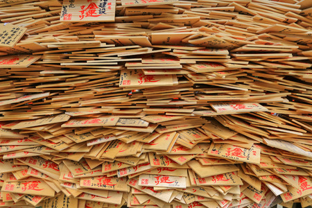 ema: A stack of wooden wishing plaques, prayer tablets called Ema in Japan in Nara, Japan.
