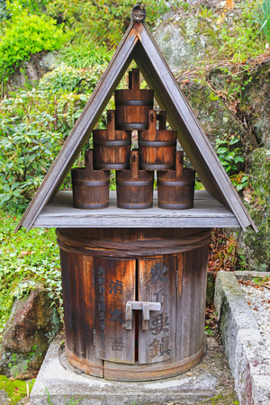 extinguish: Tradition Japanese Fire barrel and buckets from the Edo Period to prevent or extinguish fires in Magome, Japan Stock Photo
