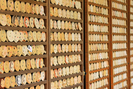 ema: Shallow depth of field of mirror-shaped wooden prayer tablets called Kagami ema in Kyoto, Japan. Its believed to paint the face, make a wish and your face will become more beautiful Editorial