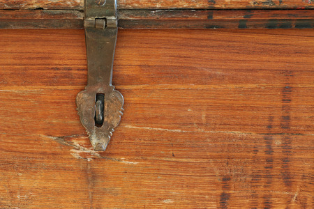 hasp: Closeup background texture photo of rustic weathered wooden box with metal hinge hasp lock Stock Photo