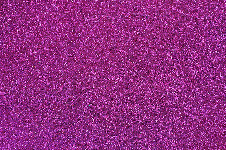 glittery: Closeup abstract background glittery texture photo of glitter in magenta shade