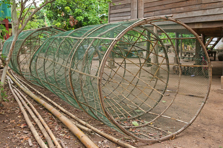 traps: Huge handmade fish traps made of bamboo and green net at the fishing village in Laos Stock Photo
