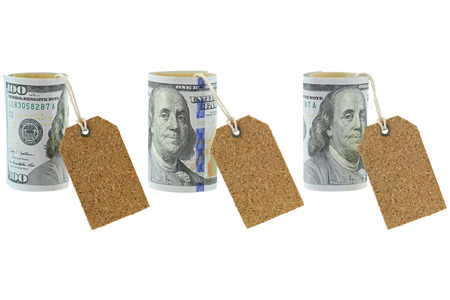 stated: Rolled new United stated 100 dollar banknote with blank natural cork label tags hanging, isolated on white