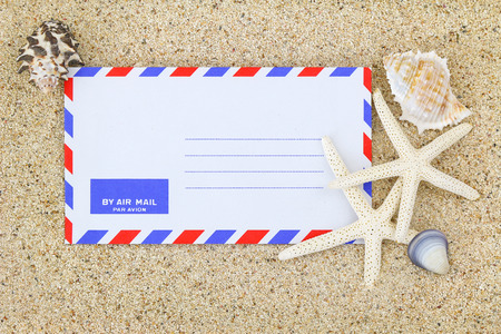 par avion: Blank classic air mail envelope on the sand decorated with sea shells and Starfish Stock Photo