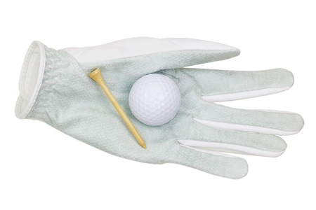 golf tee: White synthetic microfiber Golf glove with a golf ball and bamboo golf tee on it, isolated on white background