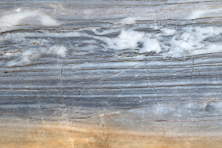 mot: Closeup abstract background texture photo of grainy marble with natural limestone pattern and yellow shade Stock Photo