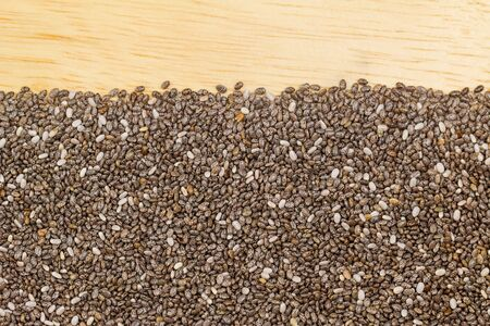 hispanica: Dried Chia seeds ( Salvia hispanica ) on wooden background with copyspace