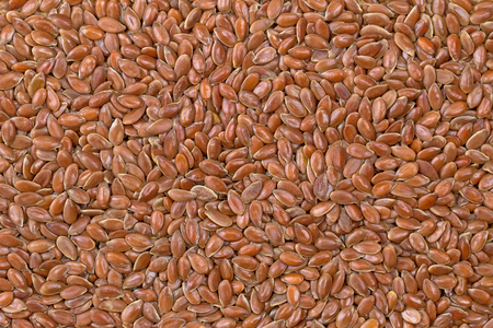 flaxseed: Closeup background texture photo of reddish brown seeds of Linseed, also called flaxseed. Flaxseed are seeds from flax plant Stock Photo